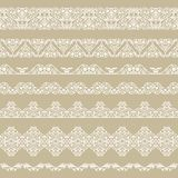 Set of borders. Set of white borders  on a beige background Stock Photography