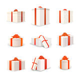 Set of white bright gift boxes with red tapes and bows Stock Photos