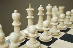 Set of white chess pieces on a chessboard close Stock Image