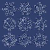 Set of  white contour snowflakes Stock Photos