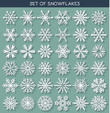 Set 36 white different snowflakes handmade with long shadow. Set 36 white different snowflakes of handmade with long shadow. Snowflake Flat. New Year's symbols Royalty Free Stock Photos