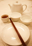 Set of white dishes , cup of tea Royalty Free Stock Photos
