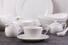 Set of white dishes Stock Images