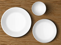 Set of white dishes on a wooden Royalty Free Stock Images