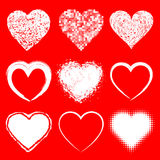 Set of white doodle grunge hearts icons on red backgroun Stock Photo