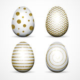 Set of white Easter eggs with gold glitter textured dots, stripes on white background. Royalty Free Stock Image