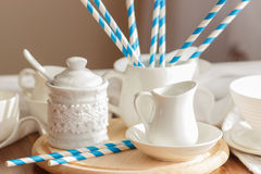 Set of white empty tableware with striped tubules Stock Image