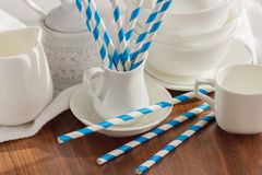 Set of white empty tableware with striped tubules Stock Images