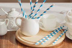 Set of white empty tableware with striped tubules Royalty Free Stock Photos