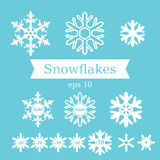 Set of white flat snowflakes on a blue background Royalty Free Stock Image