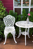 Set of white furniture with table and chairs decorated Royalty Free Stock Image