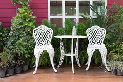 Set of white furniture with table and chairs decorated stock photo