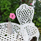 Set of white furniture with table and chairs decorated Royalty Free Stock Images