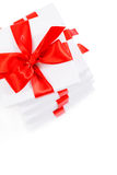 Set of white gift boxes with red ribbon Royalty Free Stock Images