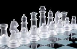 Set of white glass chess pieces Stock Photos