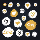 Set of white hand drawn textured spots and circles with hearts on the blackboard, Valentines Day design elements. Royalty Free Stock Image