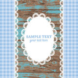 Set of white lace frame doily and ribbons on a blue wooden background royalty free illustration