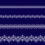 Set of white lace ribbons Stock Photo