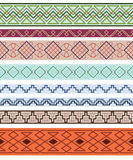 Set of white ornate borders on monochrome backgrounds. Pattern brushes are included in vector file Royalty Free Stock Images