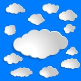Set of white paper clouds for ui, web, social media design templ. Collection of white paper clouds for ui, web, social media design template on blue background Royalty Free Stock Images