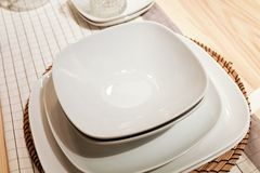Set of White Porcelain Dishes, Bowls and Plates Royalty Free Stock Images