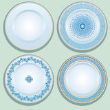 Set of White porcelain plate with blue ornament, patterned round Royalty Free Stock Image