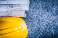 Set of white rolled up blueprints and construction Royalty Free Stock Photo