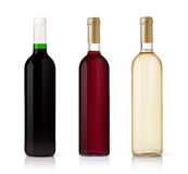 Set of white, rose, and red wine bottles royalty free stock photos