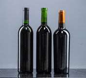 Set of white, rose, and red wine bottles. Royalty Free Stock Images