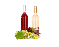 Set of white and rose wine bottles, glas and cheese, red and white grapes. Royalty Free Stock Images