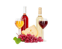 Set of white and rose wine bottles, glas and cheese, red and white grapes. Royalty Free Stock Photos