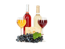 Set of white and rose wine bottles, glas and cheese, red and white grapes. Royalty Free Stock Image
