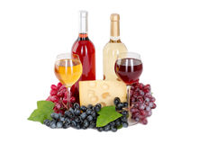 Set of white and rose wine bottles, glas and cheese, red and white grapes. Stock Image