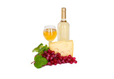 Set of white and rose wine bottles, glas and cheese, red and white grapes. Stock Images