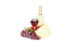 Set of white and rose wine bottles, glas and cheese, red and white grapes. Royalty Free Stock Photo