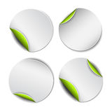 Set of white round stickers with green backside Stock Photography