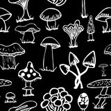 Set of white silhouettes cute cartoon mushrooms on black background. Royalty Free Stock Images