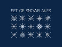 Set of white snowflakes on blue background Royalty Free Stock Photo