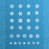 Set of white snowflakes on a blue background. Stock Photo