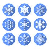 Set of white snowflakes in blue circle with long shadow. Modern design element for christmas decoration Royalty Free Stock Image