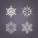 Set of white snowflakes on the grey background Royalty Free Stock Image