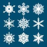 Set of white snowflakes isolated on blue background. Vector. Set of white snowflakes isolated on blue background. Vector illustration royalty free illustration
