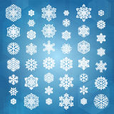 Set of white snowflakes. Silhouettes isolated on abstract geometric vector background in dark blue colors. Flat snowflakes icons for christmas cards, banners Stock Image