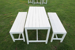 A set of white table and benches. Having party? They are ready Royalty Free Stock Image