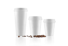 Set of white take-out coffee cups and coffee beans Stock Photography
