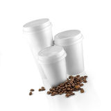 Set of white take-out coffee cups and coffee beans Royalty Free Stock Photos