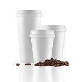 Set of white take-out coffee cups and coffee beans Stock Photos