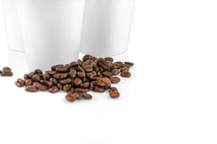 Set of white take-out coffee cups and coffee beans Royalty Free Stock Photo