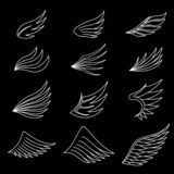 Set of white wings on black background royalty free illustration