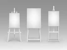 Set of White Wooden Easels with Blank Canvases Stock Images